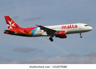 ROZENBURG, THE NETHERLANDS - June 15, 2015: Air Malta Airbus A320-200 with registration 9H-AEP on short final for runway 06 of Amsterdam Airport Schiphol.