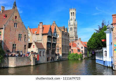 The Rozenhoedkaai (canal) in Bruges with the belfry in the background. Belgium, Europe.