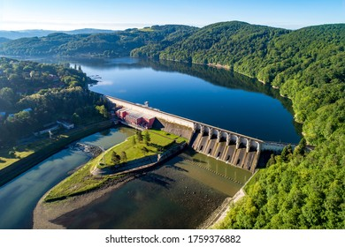 Roznow dam, lake and hydroelectric power plant on the Dunajec River in Poland. Aerial view. Early morning in spring