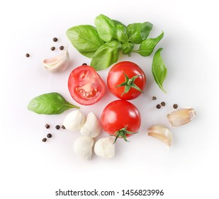 Rpe red cherry tomatos and mozzarella on white background. Top view