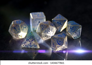 Rpg dice on table. Dungeons, monsters, dragons. Role playing game. Fantasy and adventure.