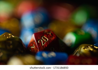 RPG style dice in primary colors with a red D20 facing 20-side up.