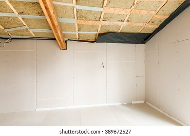 Rroom under construction with gypsum plaster boards. Roofing Construction Indoor. Wooden Roof Frame House Construction.
