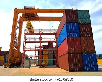 The RTG(Rubber Tried Gantry Cranes) pick up full loaded containers on stacking at industrial port and container yard
