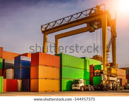 The RTG(Rubber Tried Gantry Cranes) pick up full loaded containers on truck at industrial port and container yard   for delivery to customers