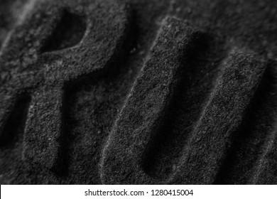 RU macro stone letters, dark, black and white photo, Russia