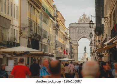 Rua Augusta with the well known arch or Arco da Rua augusta with crouds of tourists looking by on a summer day in Lisbon, Portugal.