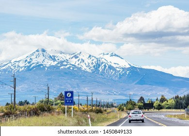 Ruapheu, New Zealand - December 15, 2017: Vehicle travelling along State Highway One on the North Island through the Ruapehu district with view of the land mark volcanic mountain.