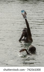 RUBANE, GUINEA BISSAU - MAY 4, 2017: Unidentified local boys swim in water during a high tide