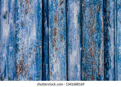 rubbed old blue wooden wall can serve as a background or for various ideas of building designers for fashionable trend textures in luxury houses, for repair or decoration, loft style is at the height