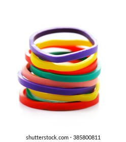 Rubber band tower on isolated white background