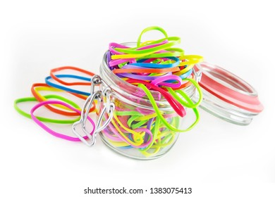 Rubber bands and jar on white background