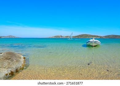 rubber boat and surfers in Porto Pollo, Sardinia