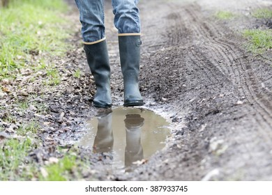 Rubber boots walking on rural path