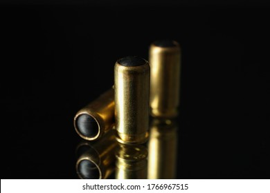 Rubber bullets on mirror background. Self defense weapon