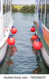 Rubber bumpers for boats of ships. On river.