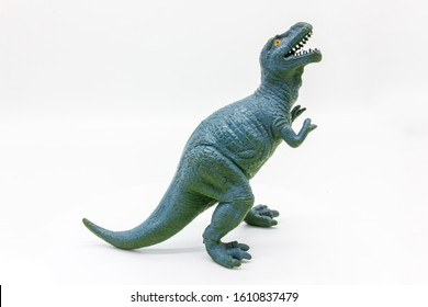 Rubber dinosaur toy. Prehistoric wild animal, danger beast, T-Rex. Isolated on white background.
