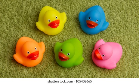 Rubber ducks isolated on a green towel