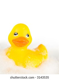 Rubber ducky in bubbles isolated on white