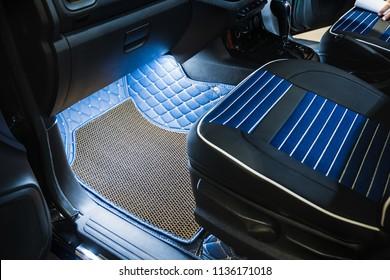 Rubber floor mat in car.