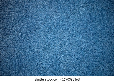 Rubber floor texture. Granules playground cover background.