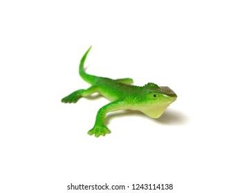 Rubber green iguana toy on white background.