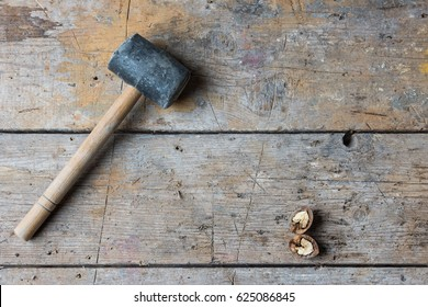 rubber hammer and walnut on the table, cracking nuts