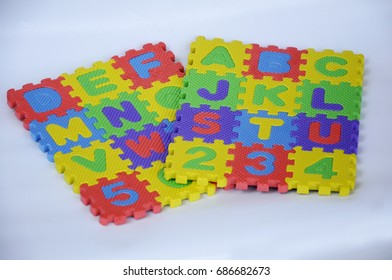 Rubber mat with colorful alphabet design isolated on white background.