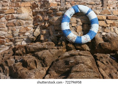 The rubber ring on the stone wall on the beach