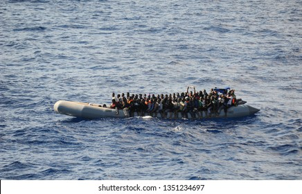 A rubber small boat full of immigrants on 3/3/2019 in the Mediterranean Sea, near from Lybia