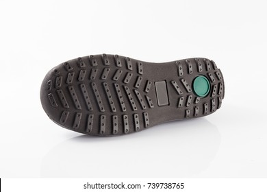 Rubber sole of boot, isolated on white background.