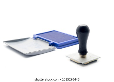 Rubber Stamp with the blue ink place on the white background.