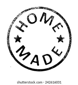 "Rubber stamp with "" HOME MADE "" text on white"