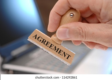 rubber stamp marked with agreement
