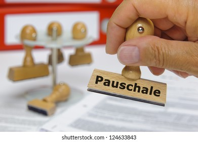 rubber stamp marked with flat rate - in german: Pauschale
