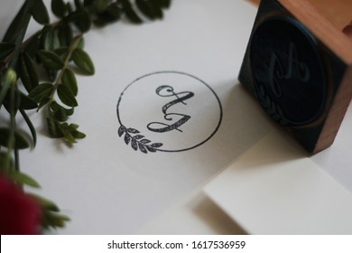 Rubber stamp monograms on a paper