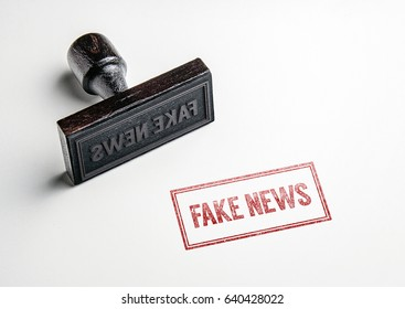 Rubber stamping that says 'Fake News'.