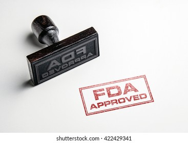 Rubber stamping that says 'FDA Approved'.