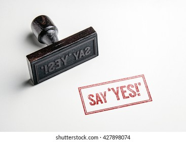 Rubber stamping that says 'Say Yes!'.