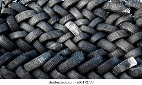 Rubber tire recycling. old used car tires  at a junkyard in piles waiting for recycle.