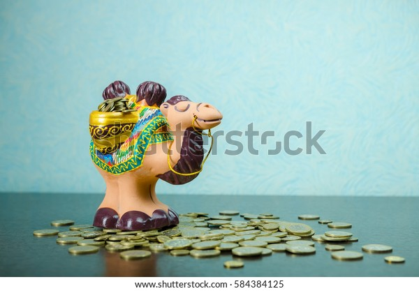 A rubber toy of camel side view and coins. money box