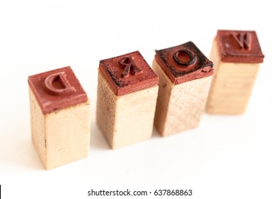Rubber and wood letter molds on white background