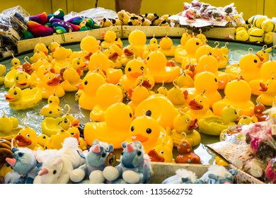 Rubber yellow ducks with hooks in their heads. Fairground hook a rubber duck chance game.