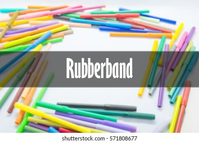 Rubberband  - Abstract hand writing word to represent the meaning of word as concept. The word Rubberband is a part of Action Vocabulary Words in stock photo.