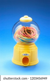 Rubberbands in Bubblegum Machine on Blue Background