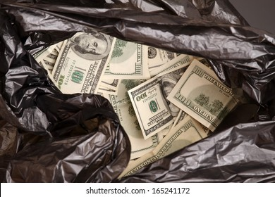 A Rubbish bag full of dollars
