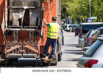 rubbish collector traveling on the lorry