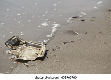 Rubbish on sand beach warm earth pollution