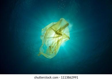 Rubbish Plastic bag floating in the ocean