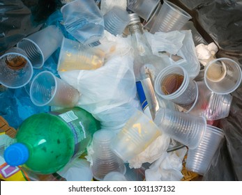 Rubbish, plastic cups. Non-biodegradable waste